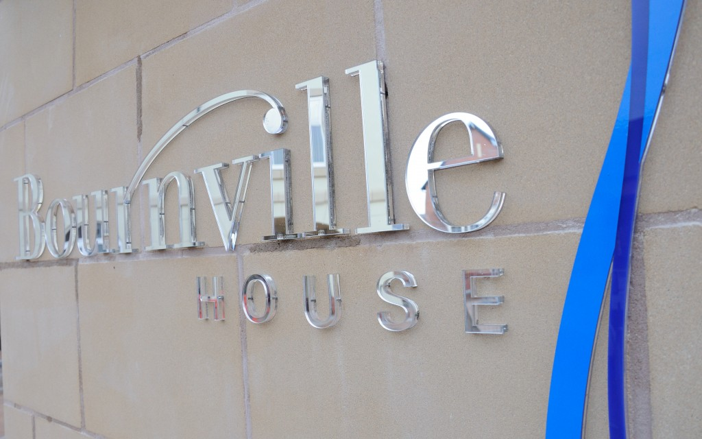 Bournville House signage made from a combination of clear and BVT blue perspex